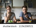 millennial couple obsessed with ... | Shutterstock . vector #1156208521