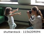 mom photographer having fun... | Shutterstock . vector #1156209094