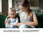 loving mother consoling or... | Shutterstock . vector #1156209097