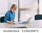 young woman working at office | Shutterstock . vector #1156220671