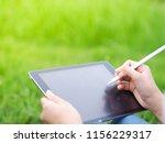 beautiful woman writing into... | Shutterstock . vector #1156229317