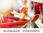 hot chilli sauce in the hands... | Shutterstock . vector #1156243054