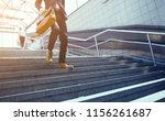 businessman in suit walking... | Shutterstock . vector #1156261687