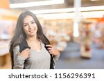 young student girl in library | Shutterstock . vector #1156296391