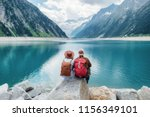 travelers couple look at the... | Shutterstock . vector #1156349101