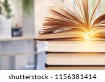 old stacked books on background | Shutterstock . vector #1156381414