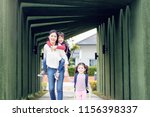 mother and kids are going to... | Shutterstock . vector #1156398337
