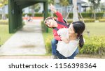 mother and kids are going to... | Shutterstock . vector #1156398364