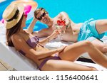 sunbathing with man. dark... | Shutterstock . vector #1156400641