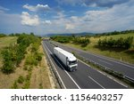 white truck driving on a... | Shutterstock . vector #1156403257