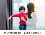 mother dressing up a son for... | Shutterstock . vector #1156438927