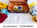 suitcase with winter and summer ... | Shutterstock . vector #1156448467