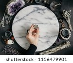 witch's hand holding smoky... | Shutterstock . vector #1156479901