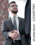 business men giving a handshake....   Shutterstock . vector #1156507987