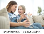 close up.happy mom and her... | Shutterstock . vector #1156508344