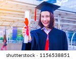 she is  graduate and wearing ...   Shutterstock . vector #1156538851