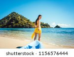 woman dragging her boat to the... | Shutterstock . vector #1156576444