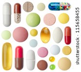 Many Colorful Pills Isolated O...
