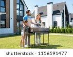 young helper. nice curious girl ... | Shutterstock . vector #1156591477
