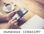 men's hands are using a... | Shutterstock . vector #1156611397