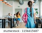 rear view of little schoolgirl... | Shutterstock . vector #1156615687