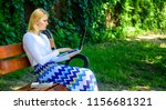 woman with laptop works outdoor ... | Shutterstock . vector #1156681321