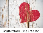 Red Heart Scratched In Wood In...
