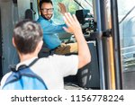 handsome smiling bus driver... | Shutterstock . vector #1156778224