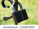 A Steel Padlock Is Attached To...