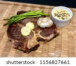 t bone steak with asparagus and ... | Shutterstock . vector #1156827661