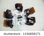 ceo and the business team at a ... | Shutterstock . vector #1156858171