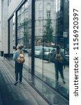 girl standing next to big... | Shutterstock . vector #1156920397
