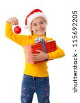 Smiling girl in Santa hat with red box and Christmas decoration, isolated on white - stock photo