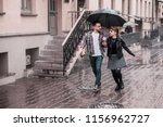 happy loving couple is under an ...   Shutterstock . vector #1156962727