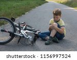 fell down of his first bike on... | Shutterstock . vector #1156997524