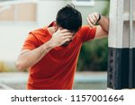 Small photo of Man suffering from dizziness with difficulty standing up while leaning on wall
