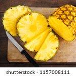 pineapple on wood texture... | Shutterstock . vector #1157008111