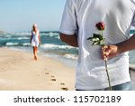 loving couple   man with rose... | Shutterstock . vector #115702189