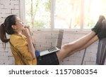 asian women are using a laptop. ... | Shutterstock . vector #1157080354