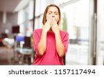 Small photo of young woman full body. Looking unenthusiastic and bored, listening to something dull and tedious, yawning in utter boredom.