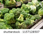broccoli selection at grocery... | Shutterstock . vector #1157128507