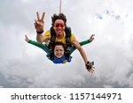 skydiving tandem happiness on a ...   Shutterstock . vector #1157144971