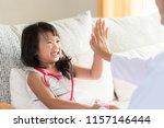 happy little cute girl on... | Shutterstock . vector #1157146444