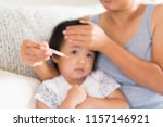 close up of a mother checking... | Shutterstock . vector #1157146921