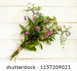 bouquet of wild flowers on a... | Shutterstock . vector #1157209021