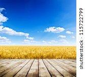 Wood Floor Over Yellow Wheat...
