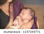 newborn baby in the hands of... | Shutterstock . vector #1157245771