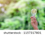 hand holding light bulb with... | Shutterstock . vector #1157317801