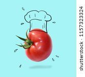 chef hat with tomato concept on ... | Shutterstock . vector #1157323324
