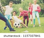 cheerful children are jogning... | Shutterstock . vector #1157337841